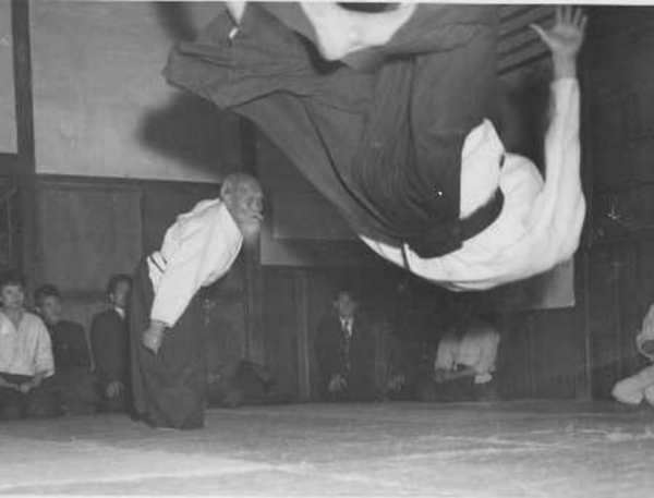 Hiroshi Tada taking ukemi from Aikido Founder Morihei Ueshiba