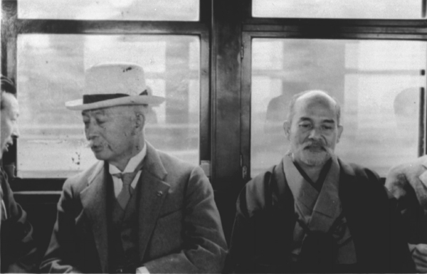 Morihei Ueshiba and Isamu Takeshita on the train